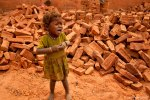 "Children are put to work, too; here, a child stands in a kiln in Nepal. ""So pervasive was the heat and the dust that my camera became too hot to even touch and ceased working,"" Kristine said of her experience there. ""Every 20 minutes, I'd have to run back to our cruiser to clean out my gear and run it under an air conditioner to revive it, and as I sat there, I thought, 'my camera is getting far better treatment than these people.'"""
